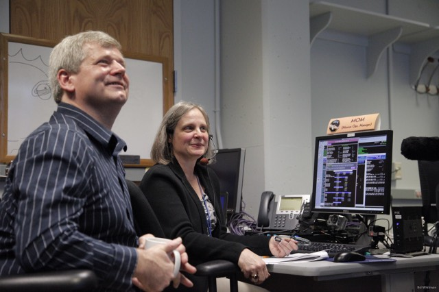 New Horizons Mission Operations Manager Alice Bowman and operations team member Karl Whittenburg watch the screens for data confirming that the New Horizons spacecraft had transitioned from hibernation to active mode on Dec. 6.
